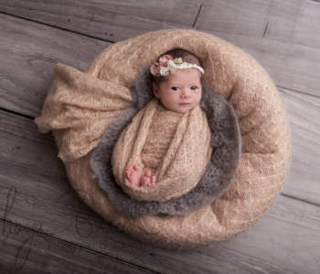 newborn baby girl awake pose