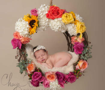baby girl in dreamcatcher with flowers