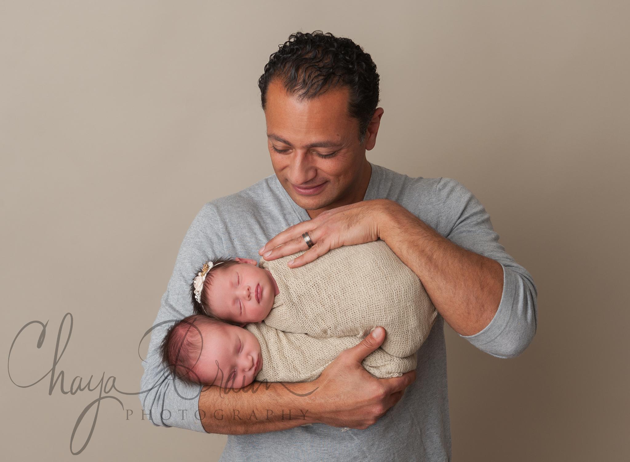 Dad with newborn baby twins