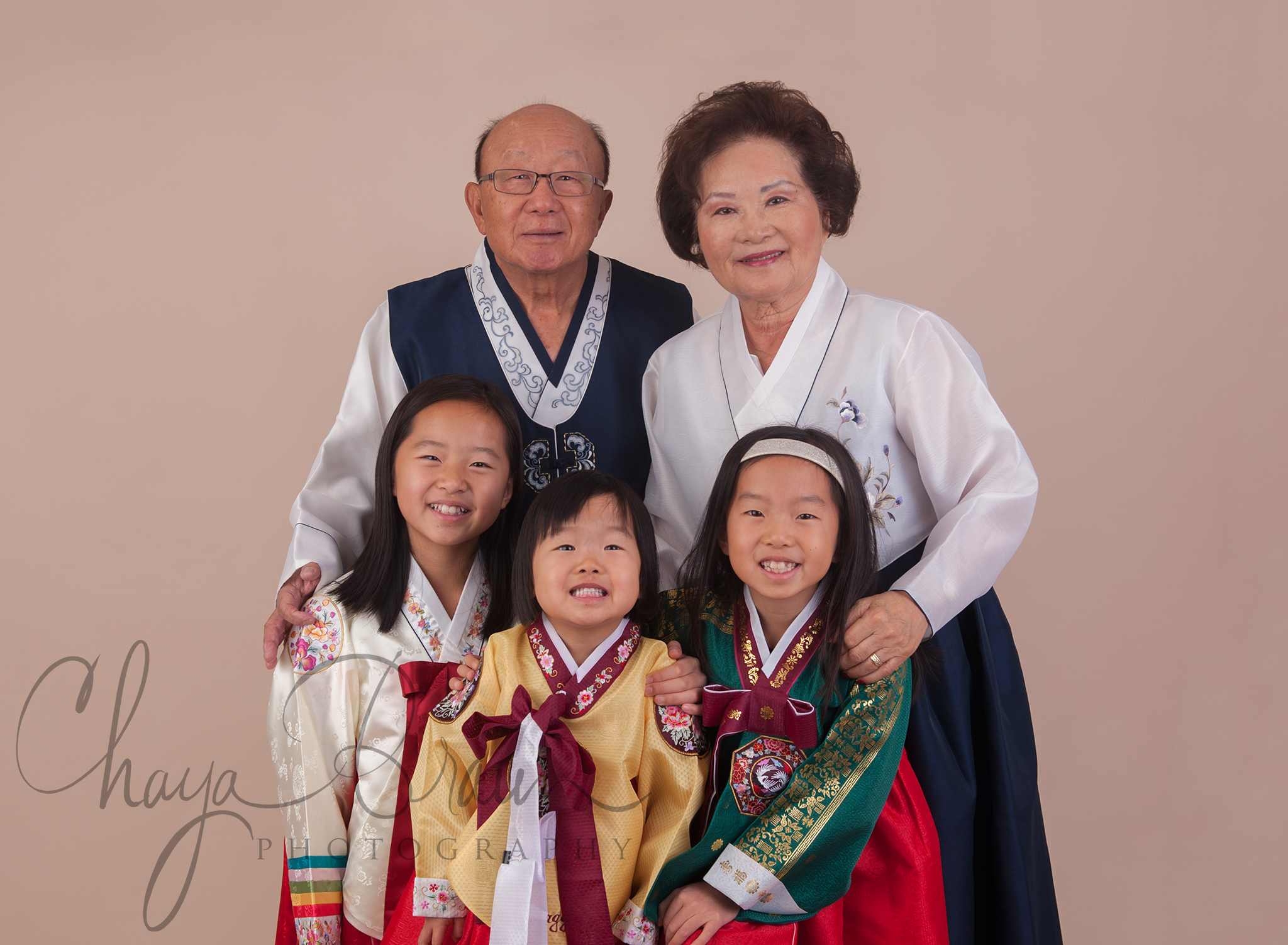 family with traditional Korean clothing photo