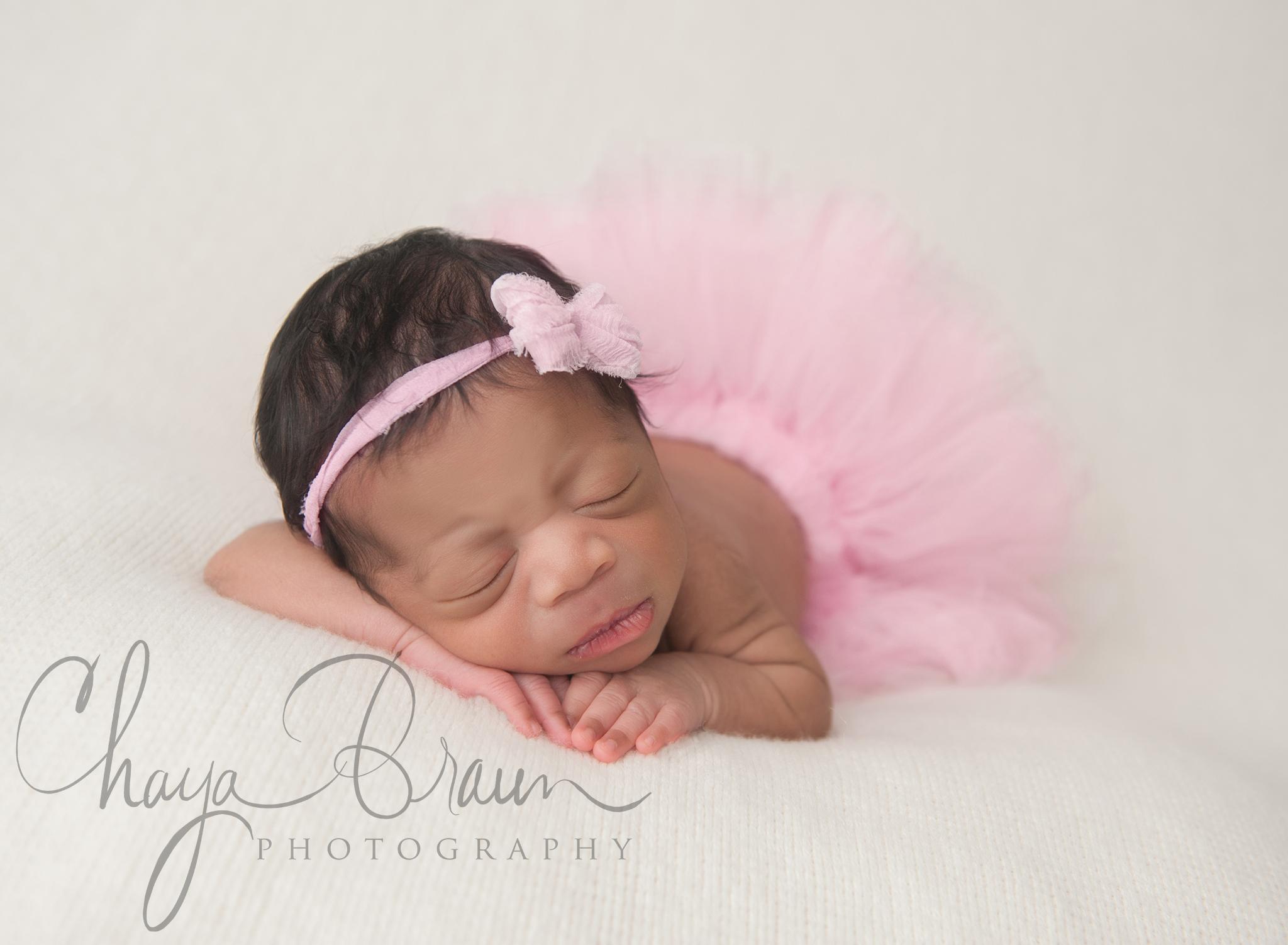 newborn baby wearing tutu