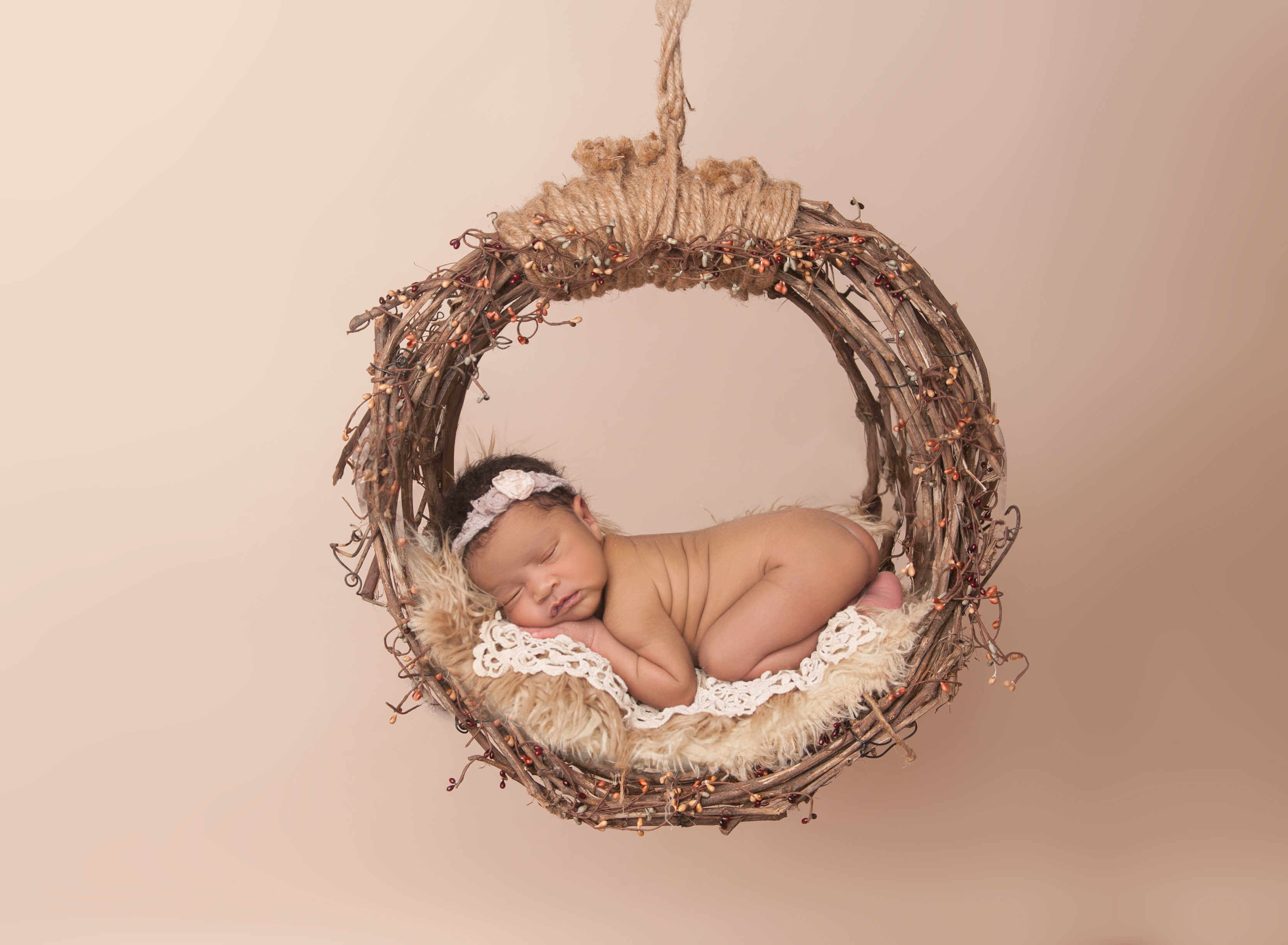 newborn baby in dreamcatcher