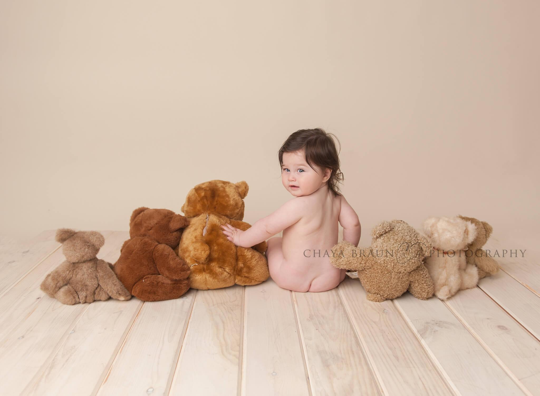 baby sitting backwards with teddy bears