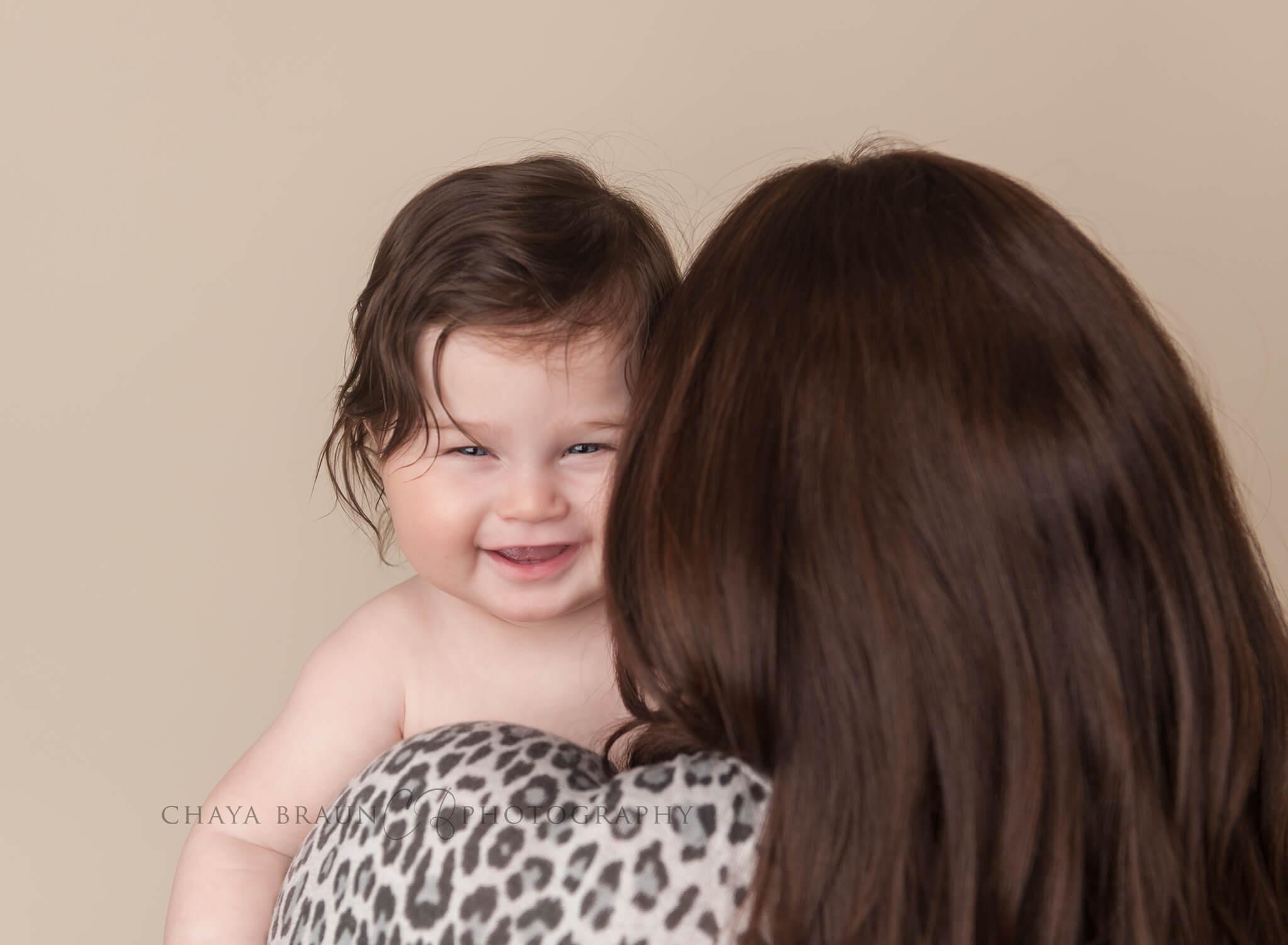 baby over mom's shoulder