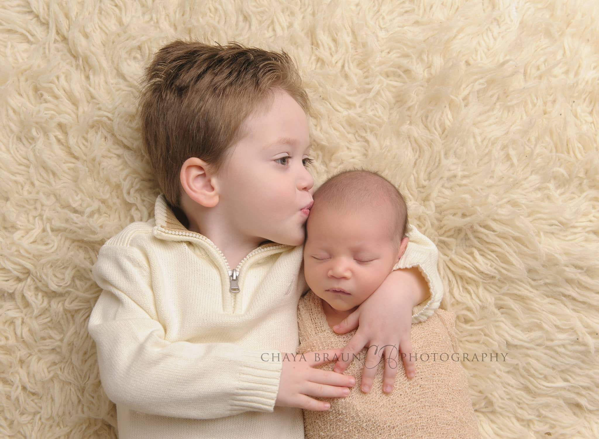 newborn and brother professional photo in Baltimore