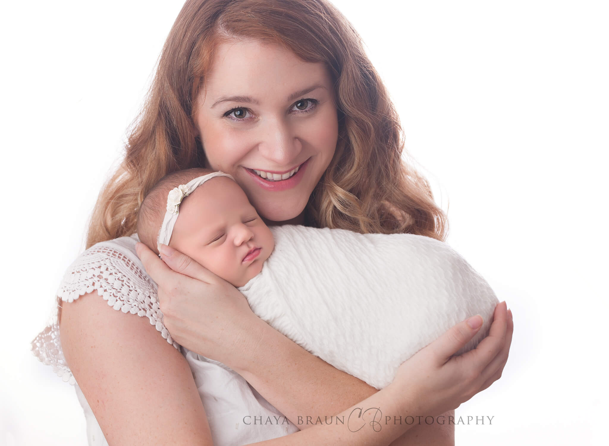 mother holding newborn baby girl