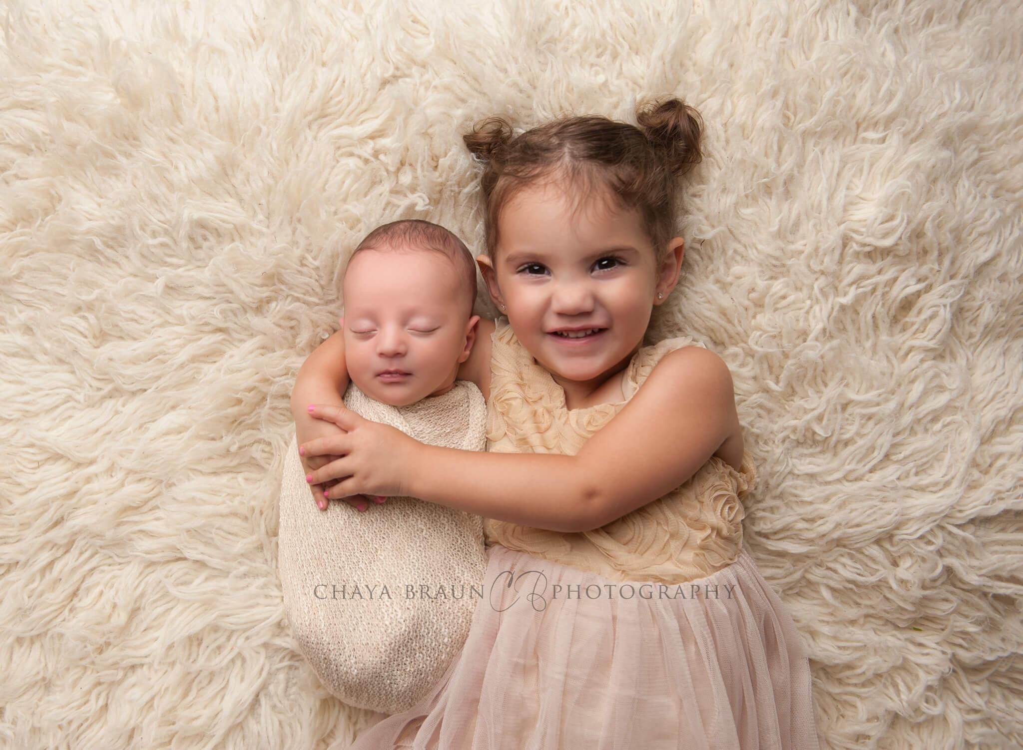 newborn baby and sister