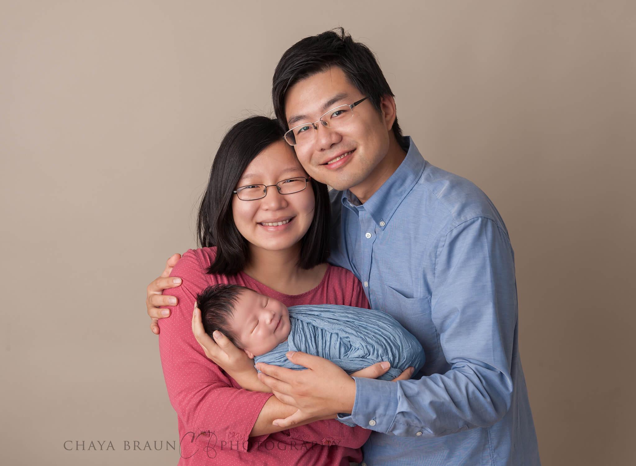 parents and smiling newborn