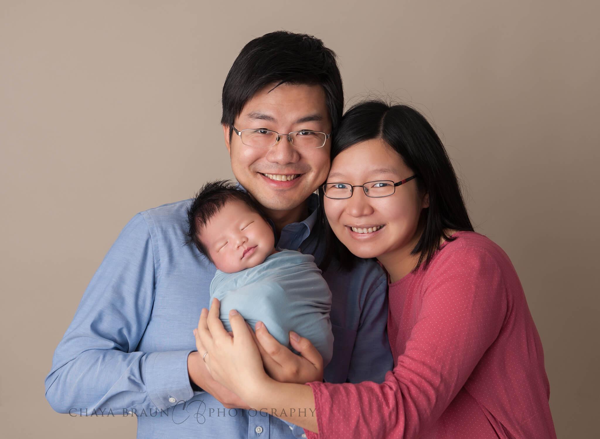 newborn baby and parents photo