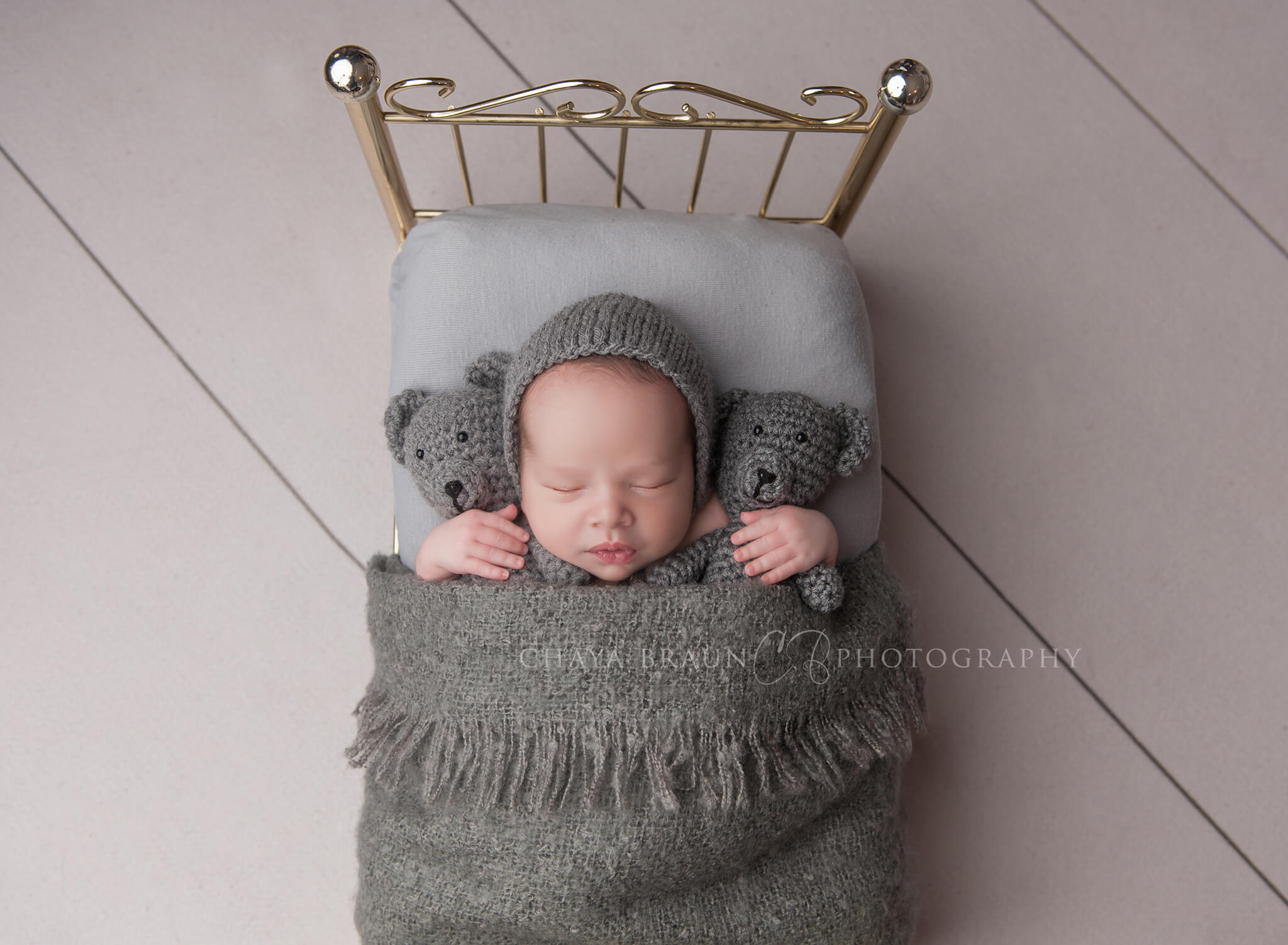 newborn baby with teddy bears