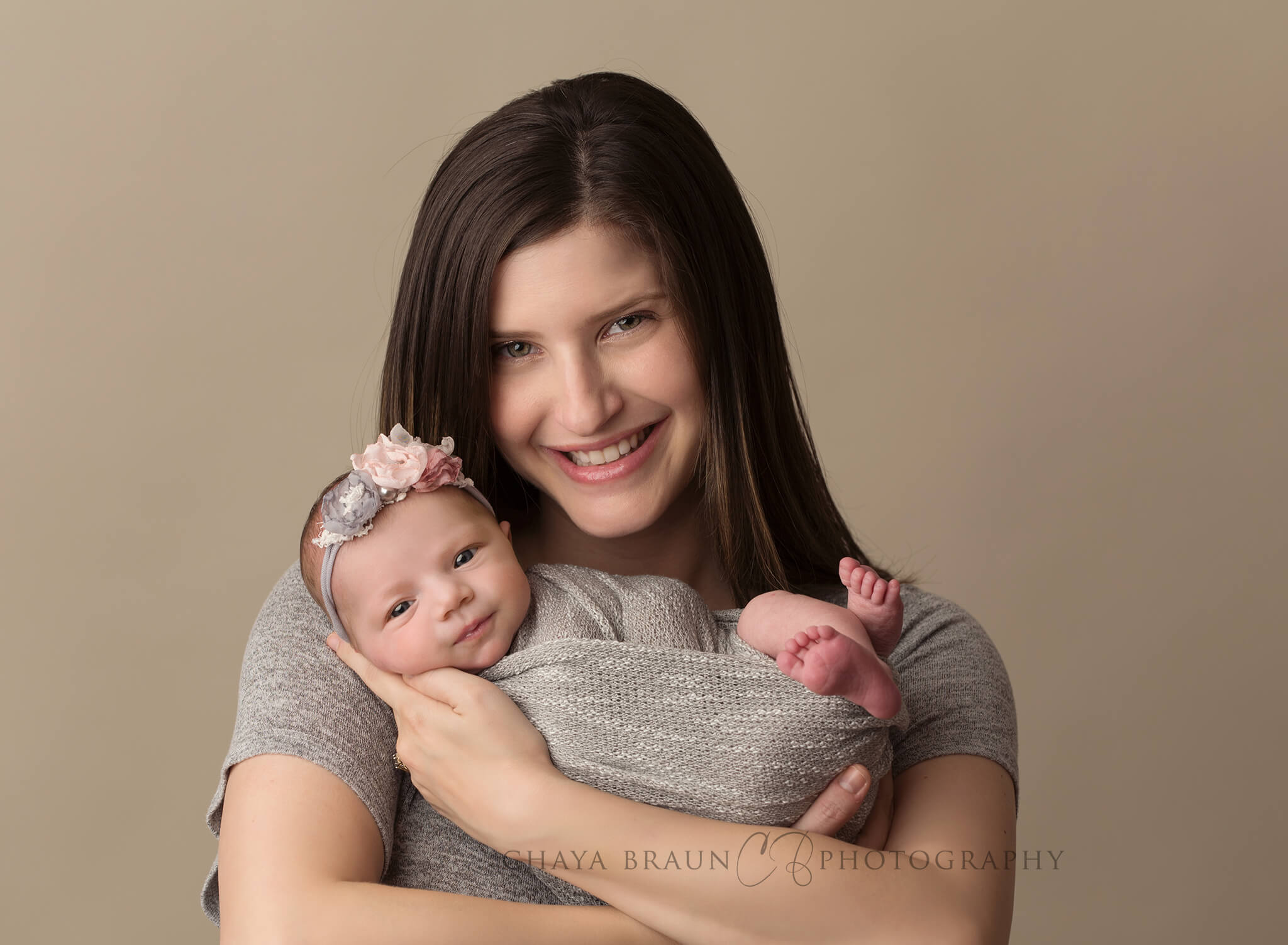 mom and newborn baby smiling