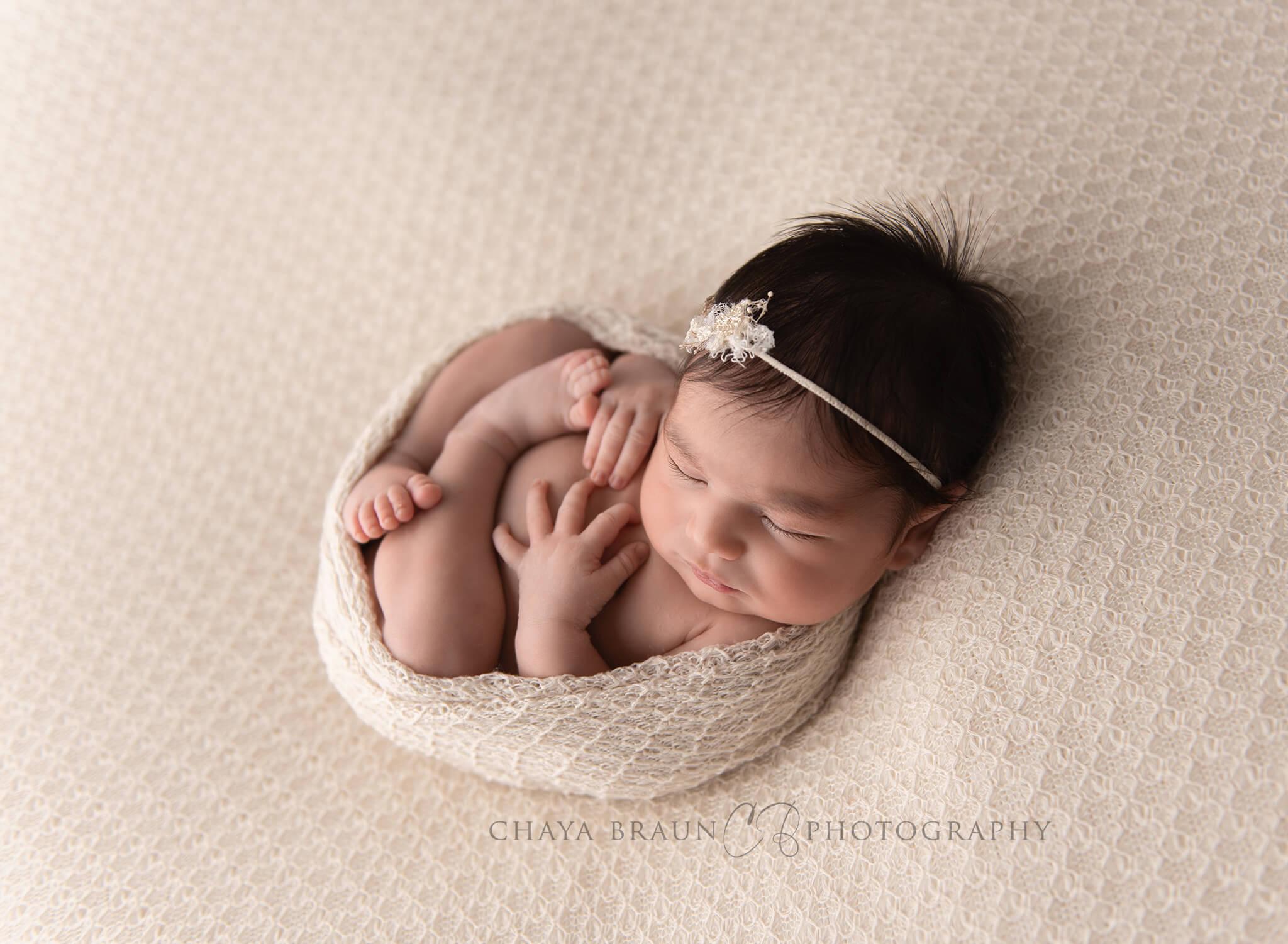 backlit newborn baby