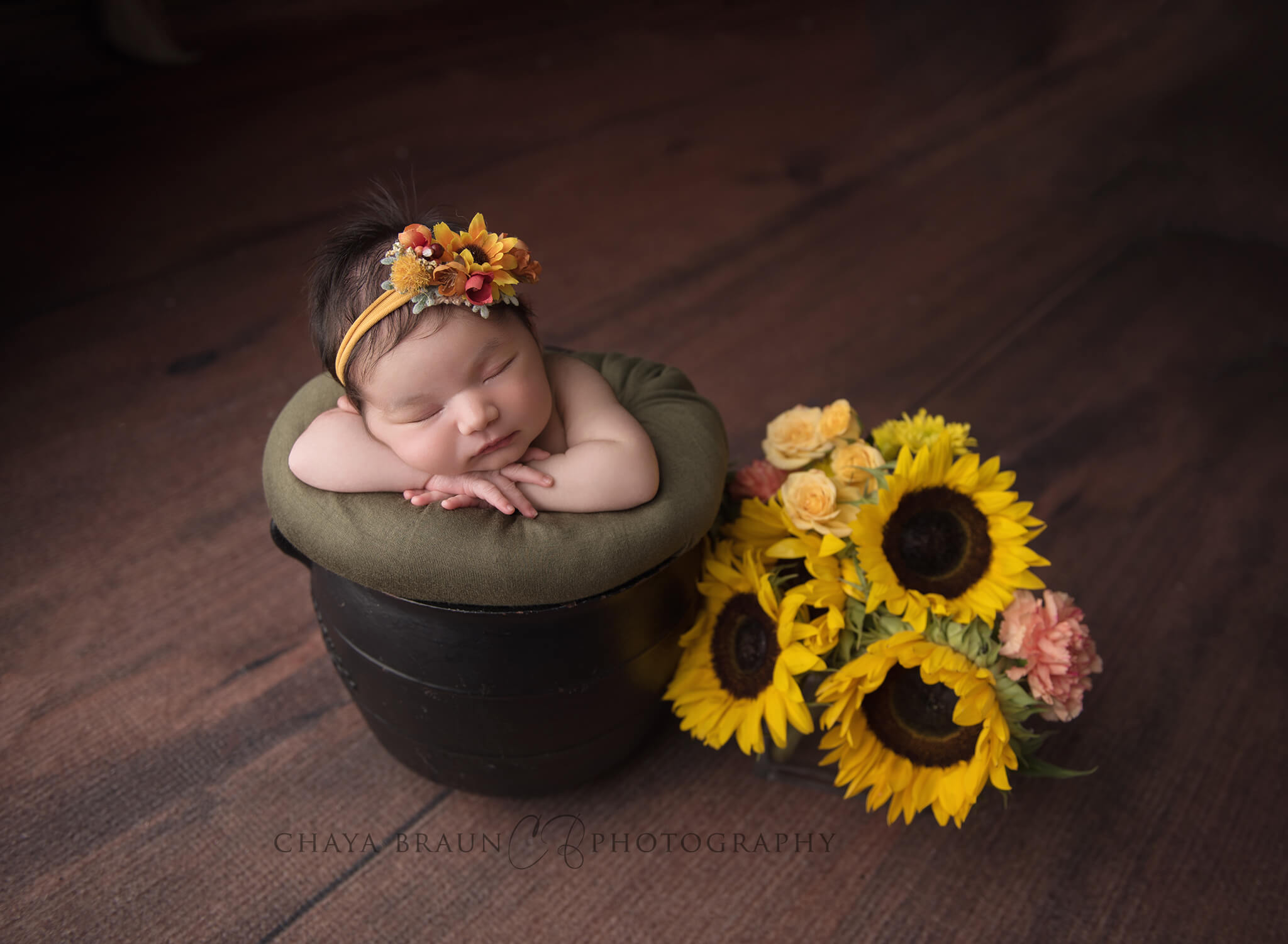 newborn baby with sunflowers