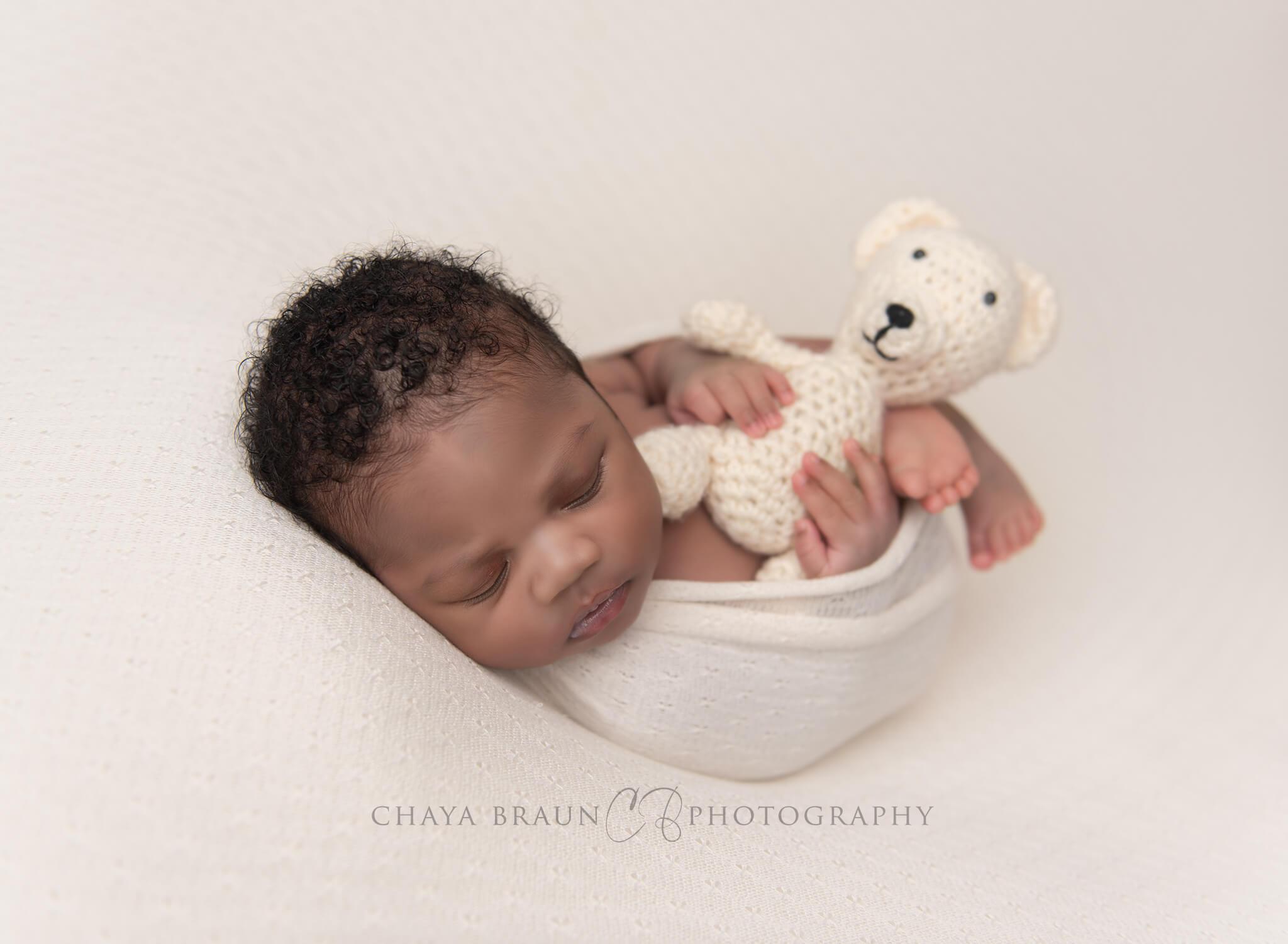 newborn baby and teddy bear