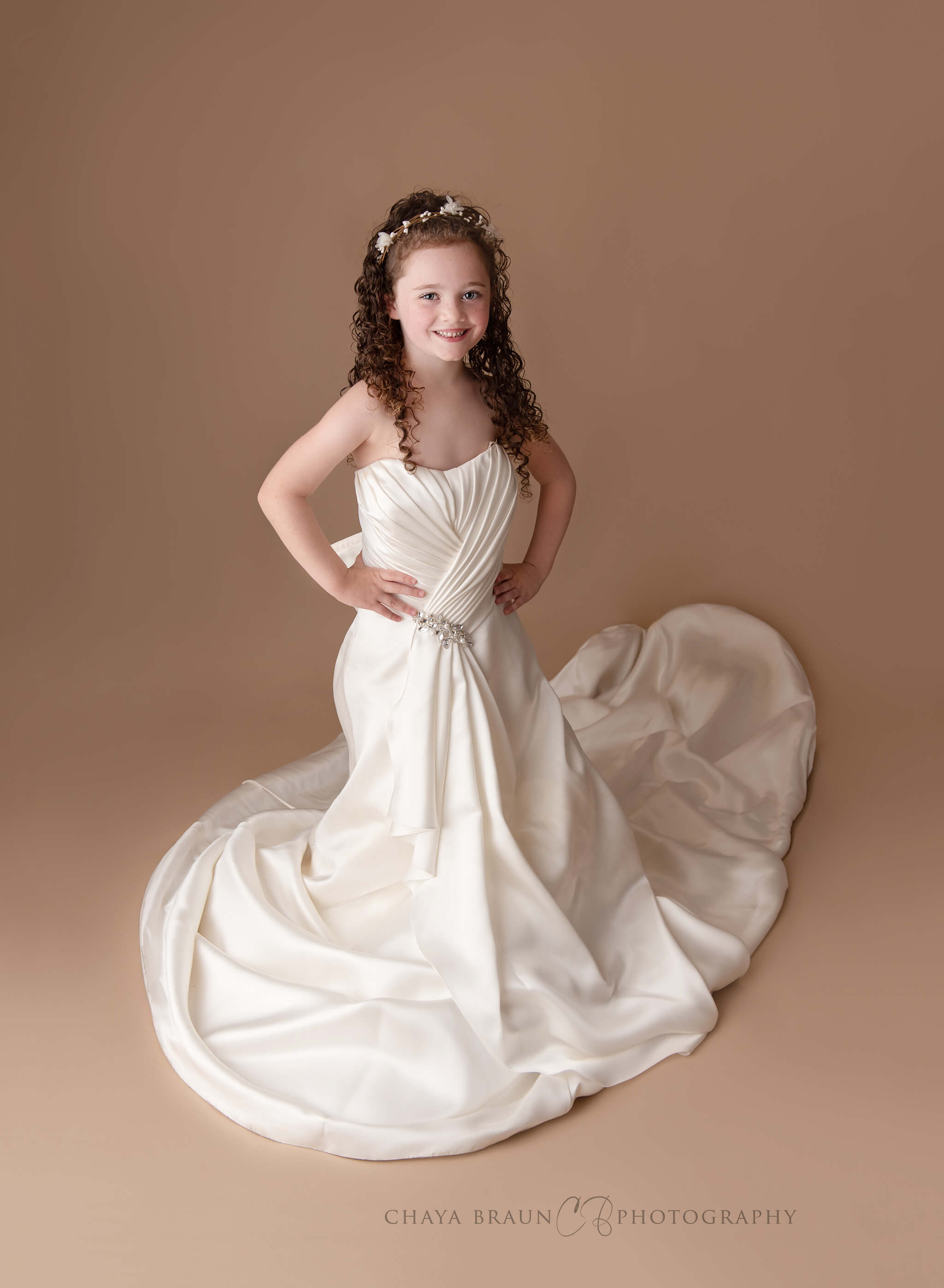 5 year old in mom's wedding gown