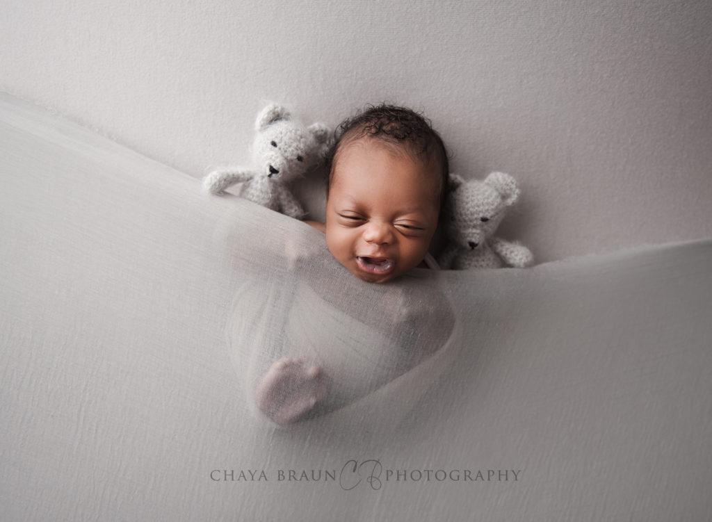 laughing newborn baby