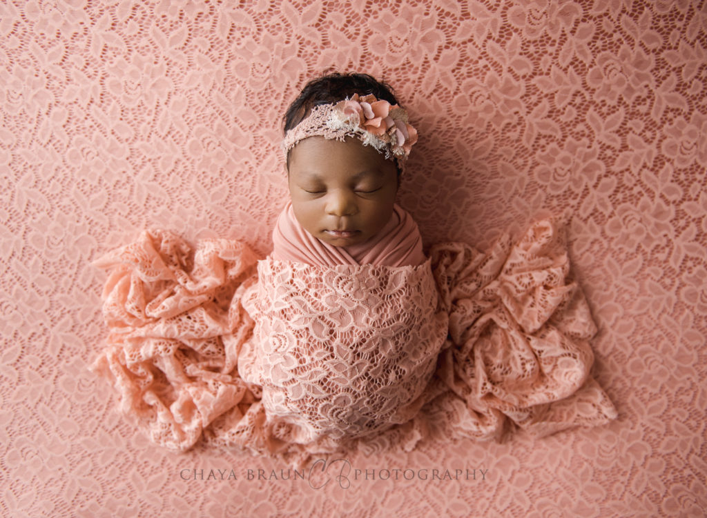 gorgeous newborn baby on lace